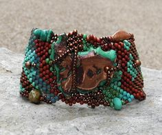 Free Form Peyote Stitch Beaded Bracelet Beaded Cuff - This bracelet is 1 1/2 inches wide at the widest point and 8 inches long. The bracelets are double stitched to reinforce its construction.