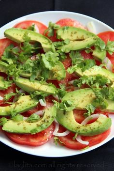 Quick salad idea: sliced tomatoes, sliced avocados, a few onions, cilantro leaves and drizzle with lime, olive oil and salt. | meatgodsmeatgods