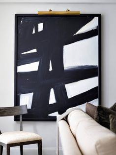 Living space with large modern monochromatic art as focal point