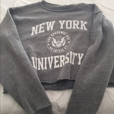 NYU cropped sweatshirt! This NYU crop top sweatshirt is so cute! Surprisingly it keeps you very warm and isn't to cropped when just wearing normal jeans verse high waisted. Brandy Melville Other