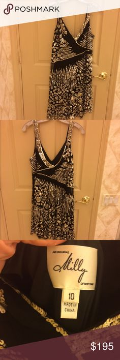 🆕🌺Milly sparkly night out dress-almost new Worn only once- purchased within one year full price at Sak's 5th. Black sexy floaty fully lined dress covered with silver sequins. Slight asymmetrical hemline. Lingerie straps. Pull on. pERFECT - Like New👍 NOT eligible for bundle❌ Milly Dresses Prom