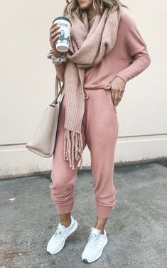 11+ Surprisingly Cute Sporty Outfits To Try: All athleisure lovers ahoy! Check out these sporty chic outfits, casual outfits and stylish gym outfits to get inspired for the new season. | Pink lounge wear with pink chunky scarf / - perfect for airport outfits. ©️️CellaJaneBlog #sportyoutfits #casualoutfits #athleisure #airportoutfits