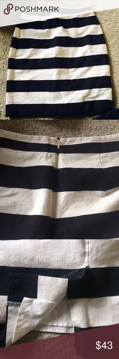Striped Pencil Skirt Beautiful black and white striped pencil skirt. Size 0. Small slit in back for flattering and comfortable fit. Zipper in back. Banana Republic Skirts Midi