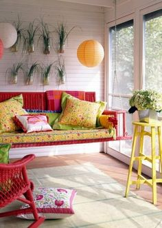 What a cool and creative idea! A porch swing used as a sofa indoors. Fun colors too!
