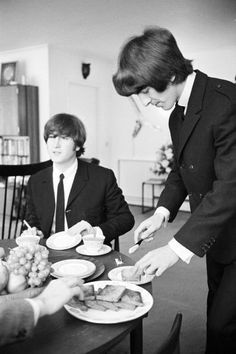 John Lennon and George Harrison (Buttering his toast)