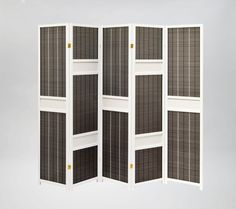 The black and white contrast of the new Sapporo Oriental Screen makes a statement for a contemporary room divider screen. Available at Futons247