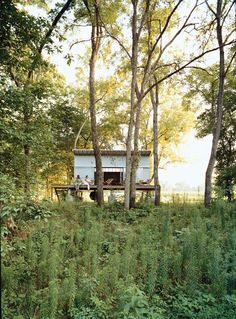 """Architect Rocio Romero placed this 312-square-foot cabin, dubbed the """"Fish Camp"""", a quarter mile from her home in rural Missouri. Despite its proximity, the structure makes for an ideal forest getaway."""