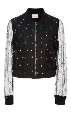 A bold, crafty twist to the bomber jacket, this **Mary Katrantzou** jacket features a layer of tulle with vibrant pom poms.