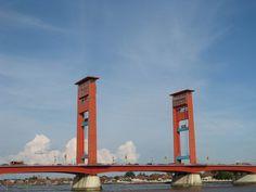 ampera bridge, located on musi river, one of palembang famous landmarks