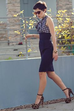 Navy blue high wasted skirt paired with a silk top and high heels