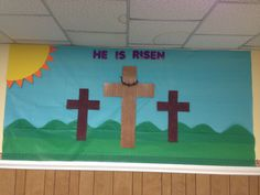 Easter Bulletin Board Sunday School  I used table cloth for the sky and grass and made the crown of thorns with pipe cleaners