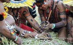 Kayapo and Xerente men prepare to light a fire using a traditional method. Picture: ANTONIO SCORZA/AFP