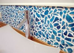 Looking for cool DIY bathroom ideas? You do not need to look any further than this Mason Jar Mosaic DIY Backsplash. Making your own backsplash is a great way to make your space unique. The tinted blue mason jars create a serene DIY backsplash. Cheap Backsplash Tile, Backsplash With Dark Cabinets, Cheap Kitchen Cabinets, Beadboard Backsplash, Diy Cabinets, Kitchen On A Budget, Kitchen Backsplash, Kitchen Ideas, Travertine Backsplash