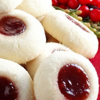 Grandma's Perfect Jam Thumbprint Cookies ~ Melt-in-your-mouth classic raspberry and strawberry jam thumbprint cookies perfect in every way and just the way Grandma made! Buttery, tender-crumbed, sweetened just right and perfect for Christmas. In fact, the Christmas Cooking, Christmas Desserts, Christmas Treats, Christmas Time, Christmas Cookie Recipes, Christmas Parties, Italian Christmas Cookies, Christmas Biscuits, Christmas Cupcakes