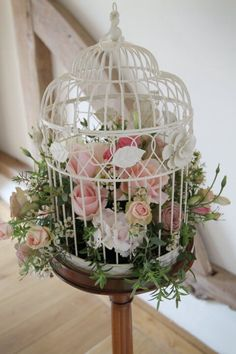 Floral birdcages for table centrepieces. We adored them on our wedding day, so wanted to share! : )