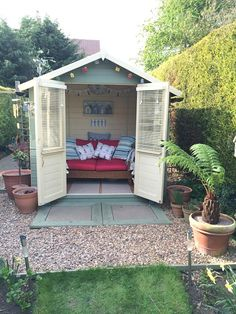 Gorgeous summerhouse by our customer, Amanda. We love the shed fairy lights above the doors. The building is our Waltons Bournemouth Summerhouse. shed design shed diy shed ideas shed organization shed plans Wooden Summer House, Summer House Garden, Summer Houses, Summer House Decor, Small Summer House, Corner Summer House, Wooden House, Diy Shed Plans, Storage Shed Plans