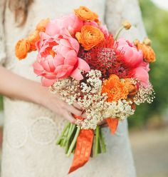 a bouquet with pink peonies and orange ranunculus - love!