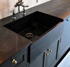 Lab top or American (Appalachia), Brazilian, Finnish soapstone (with mineral oil finish to darken it). Because of its resilience and adaptability, soapstone can be used for much more than countertops; it works well as sinks, fireplace surrounds (thanks to its heat resistance), flooring, and throughout the bathroom. It's also a great choice for outdoor counters and sinks as it's impervious to weather and bacteria.