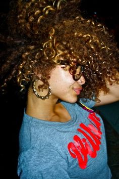 short curly kinky brown red hair. glasses