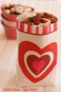 Valentine Trail Mix    1 cup no-salt raw almonds  1 cup pecan halves  1/2 cup walnuts  1 cup yogurt covered pretzels  1/2 cup yogurt covered raisins  1/2 cup pumpkin seeds  1/3 cup Valentine M & M