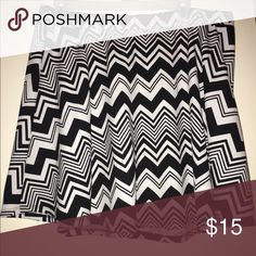 Rue 21 black/white Skirt Rue 21 skirt. Black/white. Design is same on back. So that's why I didn't take a pic of that. Size XL only wore it once. Great condition! 👍🏾 Rue 21 Skirts Mini