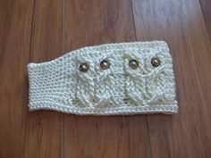 """Its a Hoot! An Owl Headband or Earwarmer is done in beautiful cables for you to create 4 """"owls"""" around the forehead and is tapered at the nape of the neck for comfort. The """"owls"""" eyes are buttons which are attached during the actual crochet work and not sewn after. So no sewing on later!!! Standard 5/8 Inch buttons were used, but pony beads may be used as well. You can find glow in the dark pony beads inexpensively at Walmart and those could be used for the eyes,, how fun!!!"""