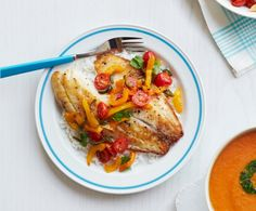 Kick up seafood night with tender tilapia doused in a spicy pepper relish. Get the recipe.   - WomansDay.com