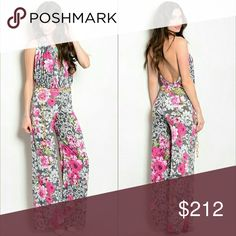 Lovely floral print jumpsuit NWOT Alluring and flattering floral print jumpsuit!   Halter neckline-Fully exposed back-Flared pants-removeable chain belt included  Material-95%polyester/ 5%spandex  New no tags Multi colored Pants Jumpsuits & Rompers