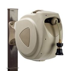 """Retractable Hose Reel - Frontgate by Frontgate. $89.50. Hose feeds out and retracts easily. Comes with 6-ft. leader hose and 100' of 1/2"""" diameter hose (nozzle not included). Wall-mounting is easy with included hardware. Space-saving unit folds against the wall when not in use. Included 2-ply PVC hose has a 290-psi burst strength and is 4-1/2 mm thick with nylon braiding reinforcement. Wall-mounting is easy with included hardware. Space-saving unit folds against the..."""
