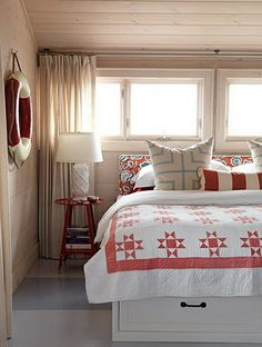 Cottage bedroom--- storage under the bed is a great idea...if I ever get back to island house