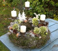Have fun with the kids, gathering all the bits from the forest while you're camping - What a wonderful way to celebrate Christmas.remembering your summer vacation, while you're making this! Christmas Advent Wreath, Christmas Candles, Christmas Crafts, Christmas Decorations, Xmas 2015, Christmas 2015, White Christmas, Theme Noel, Christmas Inspiration