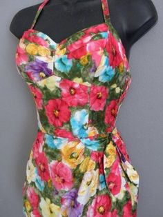 RARE 1950s PinUp Calendar Girl Hawaiian Sarong Playsuit Swimsuit!!! Tiered boned bust. Smocked sides. Convertible straps. Sarong tie. Privacy panel. The CLASSIC beach blanket bingo bathing suit of the nostalgic 50s! I have it for sale in my eBay store - goodgollymissmollysmomma