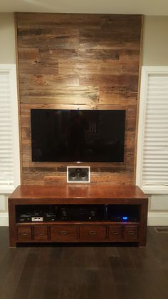 Reclaimed barn board feature wall using Barnboardstore.com weathered brown barn board