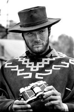 Clint Eastwood photographed with his Widelux camera on the set of FOR A FEW DOLLARS MORE by Tazio Secchiaroli (1965)