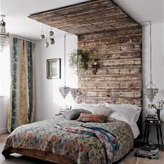 plain white walls and the two bedside chandeliers accentuate the rustic nature of the reclaimed timber canopy.