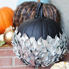 Silver leaf pumpkin-I can see doing this with a leaf die and spraying the leaves with silver spray paint.  Love the look of this.
