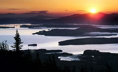 The sun rises over the mountains east of Moosehead Lake in this view from the summit of Big Moose Mountain near Greenville, Maine. Henry David Thoreau made his third and final trip to Maine's North Woods 150 years ago, traveling waterways and forests that shaped so many of his ideas about nature.
