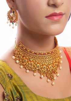 Glamorous choker necklace with beautiful chiseled flowery design, studded in ruby, emerald and pearls and matched with pretty ear studs on a sparkling matt finish metal. Adorn and be the cynosure of all eyes. Gold Chocker Necklace, Gold Choker, Choker Necklaces, Earrings, Chokers, Fashion Necklace, Fashion Jewelry, Silver For Jewelry Making, Gold Jewellery Design