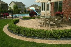 Smaller version w/ shrubs for front??Biondo Cement - Patios Gallery / 03-Stamped-Concrete-Patio-with-Retaining-Wall.jpg
