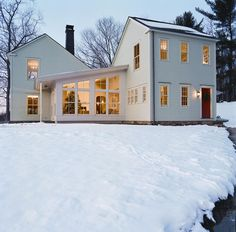 Set amid 15 acres of woodland and fields in Columbia County, south of Albany, New York, this green, saltbox-style home draws upon Colonial and Shaker inspiration.
