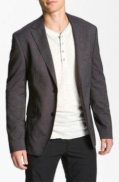 Dress up a t-shirt by pairing a nice blazer with it.