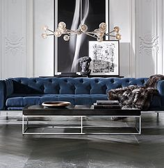 RH Modern's Italia Chesterfield Fabric Sofa:A contemporary take on a classic silhouette, our minimalist Chesterfield exudes understated elegance. Its slender legs support an expansive frame whose clean lines are complemented by a luxuriously hand-tufted seat and back.