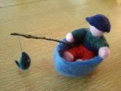 Doll Fishing in a Boat by thefeltexperience on Etsy, $50.00