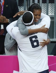 First Lady Michelle Obama hugs USA's Lebron James after USA defeated France in a preliminary men's basketball game at the 2012 Summer Olympics, Sunday, July 29, 2012, in London