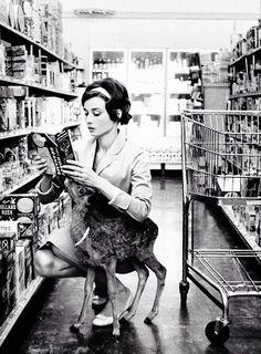 Audrey Hepburn with her pet deer. In a supermarket.
