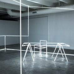 Massimo Uberti sculpts neon tubes into a room for Bentley