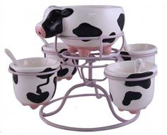 hehe I want this in my kitchen. I love cows...I want to have my whole kitchen in cow spots!