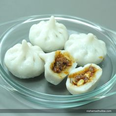 Steamed Modak is one of the most sumptuous sweet dishes made during the festival of Ganesh Chaturthi. Recipe in English - https://goo.gl/5FbFd4 (copy and paste link into browser)  Recipe in Hindi - https://goo.gl/ci5hBc (copy and paste link into browser)