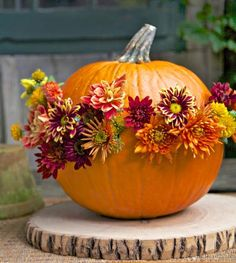 Flower-power pumpkin: This cheery design turns a pumpkin into a vessel for chrysanthemums or other fall flowers.