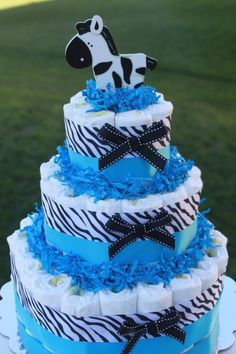 I can't figure out how to upload my own personal photos, so here is an idea of a diaper cake that will be at my shower, the theme is Blue and Zebra!